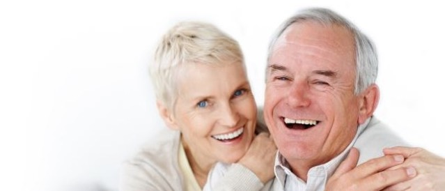 Elderly couple looking happy